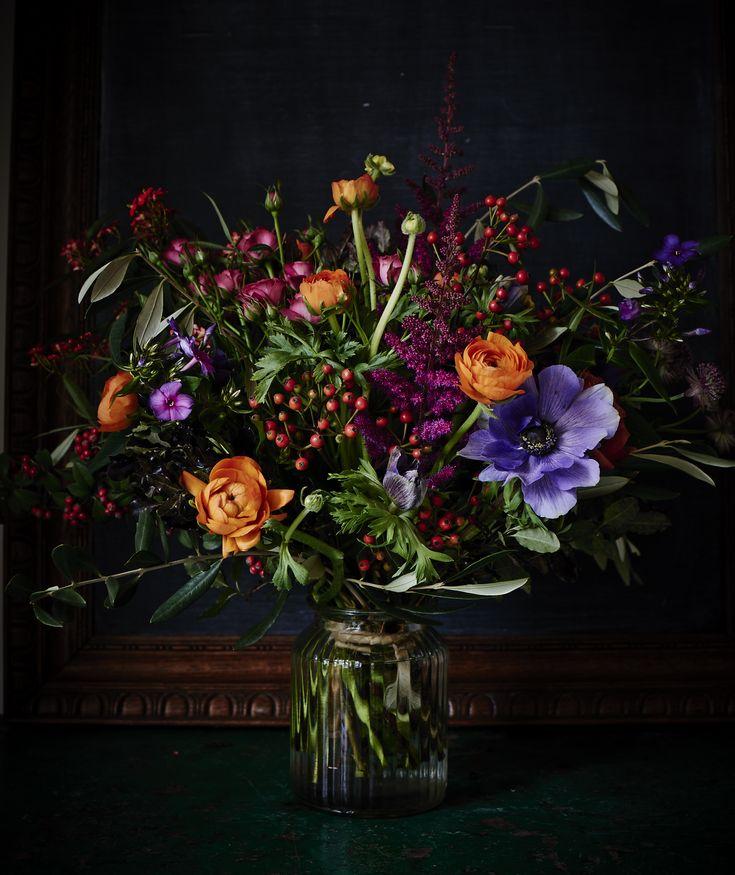 Rosehips, Anemones and orange Ranunculous by Scarlet & Violet, London England