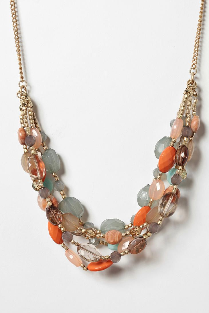 Idea - still make the entire necklace one beaded strand, but then break away at the center with multiple strands