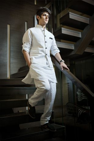 White Pure Linen short Kurta and Jodhpuri trousers. White Nehru jacket with Black Trimmings.