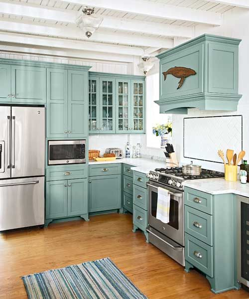 teal kitchen cabinets with glass fronts, marble countertops, subway tile backsplash, beach cottage kitchen remodel