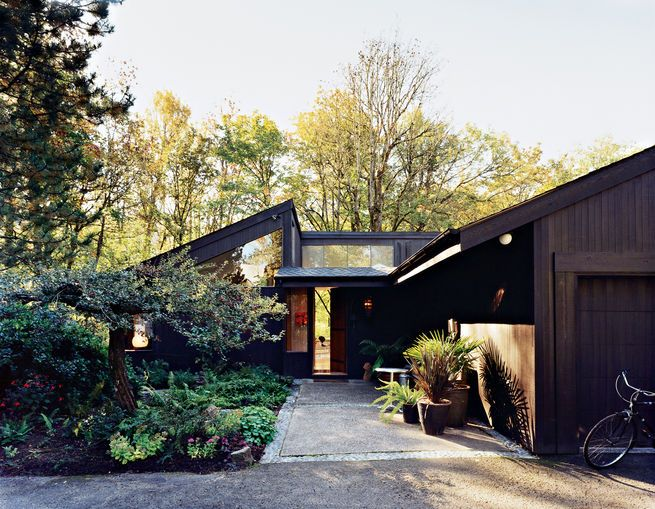 Ben Watson and his partner, Claudio Tschopp, relocated from Basel, Switzerland, to Portland's Pearl District eleven years ago. Surrounded by forests, their small Northwest and mid-century modern-inspired open-plan home, with an emphasis on natural local materials and natural light, was designed in 1972 by local architect Edgar Waehrer. Photo by John Clark.