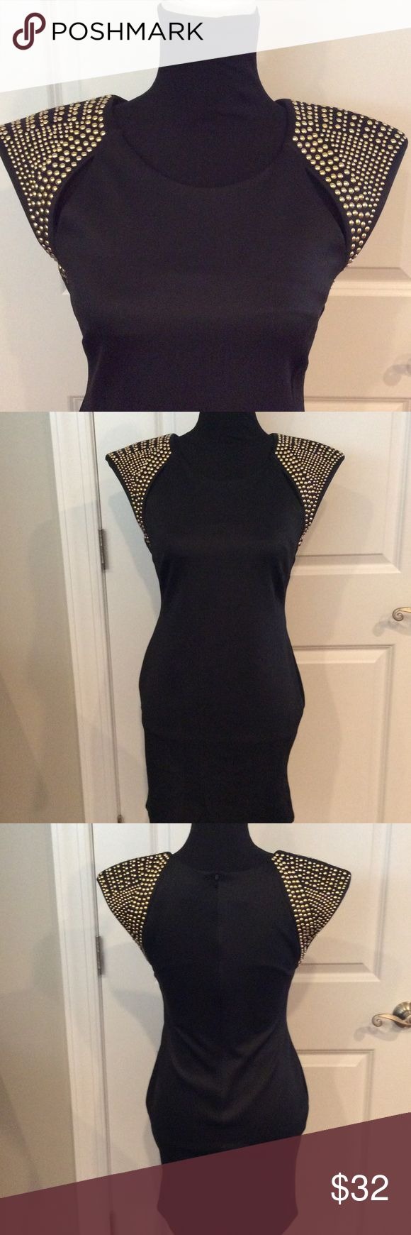 SAN SOUCI BLACK DRESS Another great find.  A beautiful black with gold accents. 95% polyester 5% spandex. Peek-a-boo accents in front of dress near shoulder bone. Zip back. Dress length 30 inches.  A GREAT DRESS AT A GREAT PRICE San Souci Dresses Midi