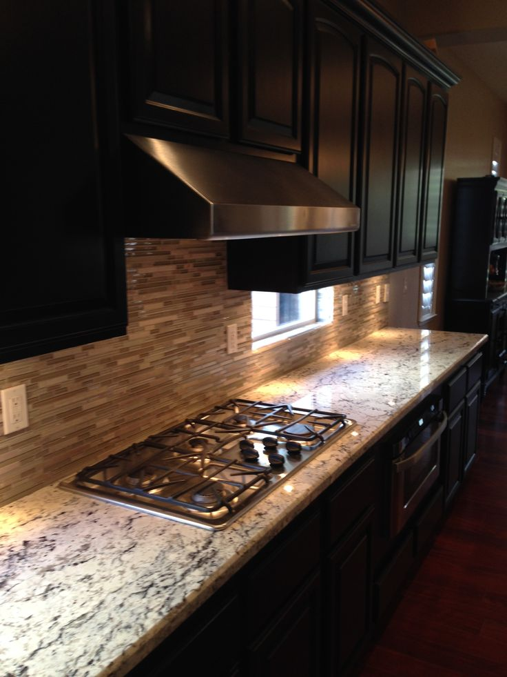 Redesigned Kitchen Including New Granite Mosaic Gl Backsplash Re Staining The Cabinets From