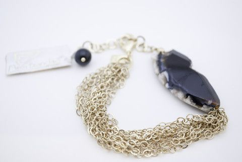 The irresistible #bracelet shines with beautiful worn out #black and #white stone. Handcrafted from 18k plated gold it features multiple links for the classiest fit. Approx. Length: 8 inches.