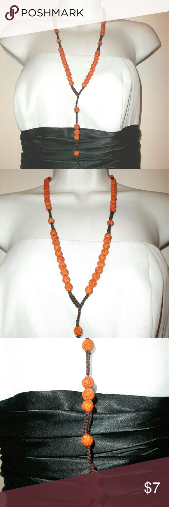 Rosary Beads Necklace in Orange Flowers This is a handmade new rosary Beads Necklace.   It is orange in color and the beads are resin flowers strung on nylon cord. The beads are set in decades and arranged just like a prayer rosary, so this necklace can be used for prayer. Measures 20 inches end to end.   The cross is a resin material. I have other colors available!  Please, no offers except with bundles. Jewelry Necklaces