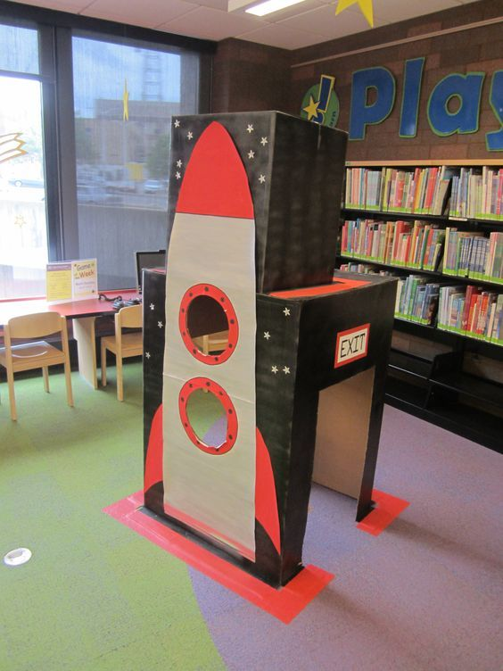 Play and Learn at the library: Space theme - rocket out of a refrigerator box for dramatic play. Kids liked peeking out of the portholes.
