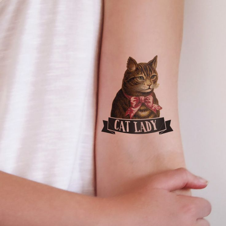 Cat lady temporary tattoo... a good way to freak out my husband. ..