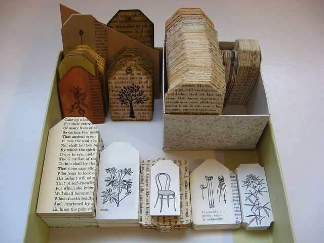 tags punched out from old books and dictionaries salvaged from recycling.