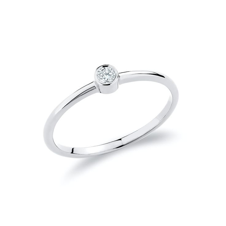 Stacking solitaire ring with one diamond set in 18K white gold.