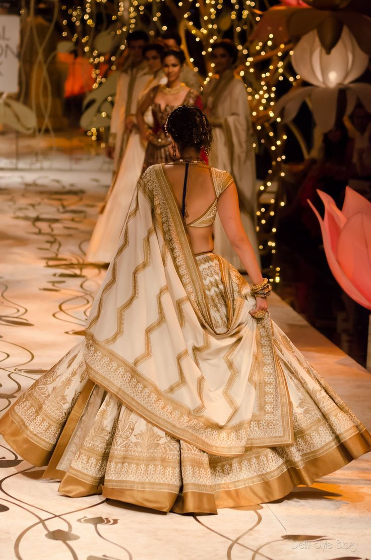 A timeless gold and ivory Rohit Bal lehenga. Shop for your dream wedding lehenga, with a personal shopper & stylist in India - Bridelan, visit our website www.bridelan.com #Bridelan