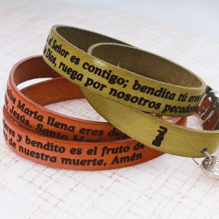 "Take a blessing everywhere you go with these leather bracelets, engraved with the words for ""Hail Mary"" in Spanish. Get it here / Lleva una bendición a donde quiera que vayas con estos brazaletes de cuero grabados con las palabras del ""Ave María"". Consíguelo aquí"