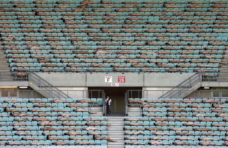 Thousands of naked people posed at Vienna's Ernst-Happel stadium during a massive photo session with Spencer Tunick, on May 11, 2008. (AP Photo/Ronald Zak)
