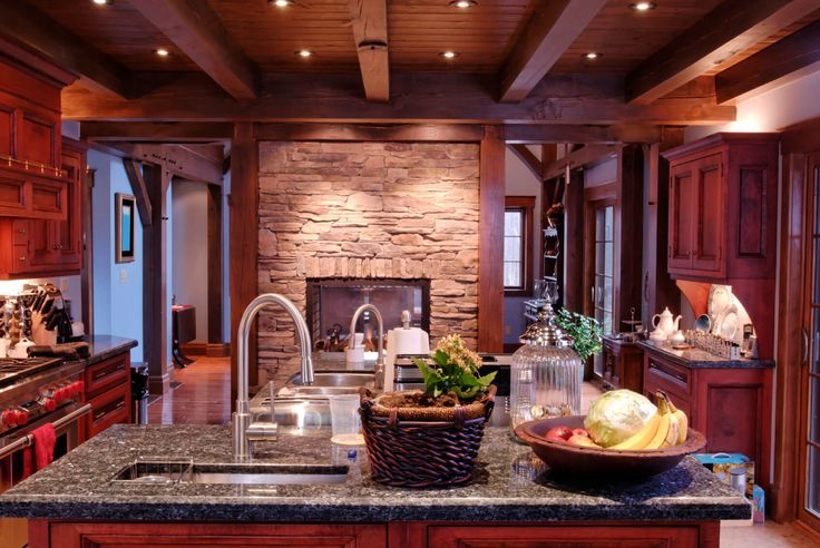 Here we see the prior rustic look kitchen at night time, with embedded light hig…