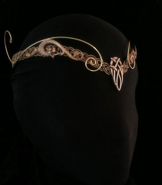 This is a stunning handmade celtic circlet woven from Gold and Black wire and crafted into a flattering V shape across the forehead,  The center
