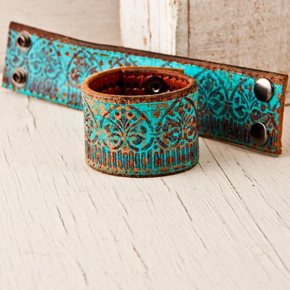 A BOHEMIAN leather cuff bracelet is handcrafted from an UPCYCLED reclaimed belt. This hand painted leather is first cut into a band, then holes are