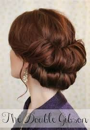 double chignon holiday hair 2014   For appointments at Stewart & Company Salon, call (404) 266-9696.