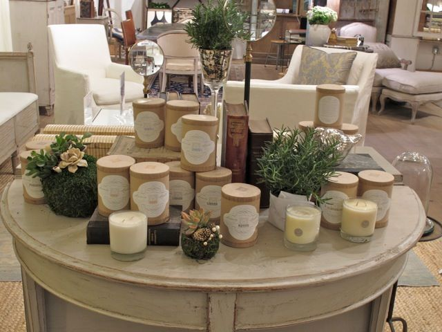 candles on the round table mixed with some greenery