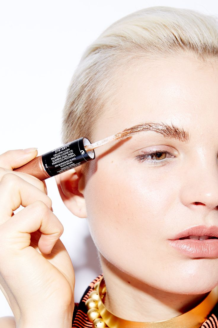 """""""Follow the natural grain of the hair, using the glitter [end of the Revlon Eye Art],"""" Paré says. You should use the same technique as if you were filling in your brows with a regular pencil. Flick in an upward motion toward the inner ends of your brows, and then draw out."""