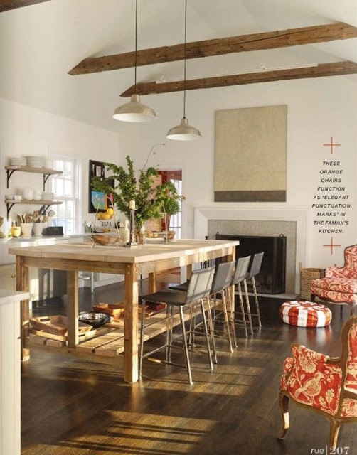 High Street Market: The New Rue -- white walls, wood floors, wood beams, open shelving island.