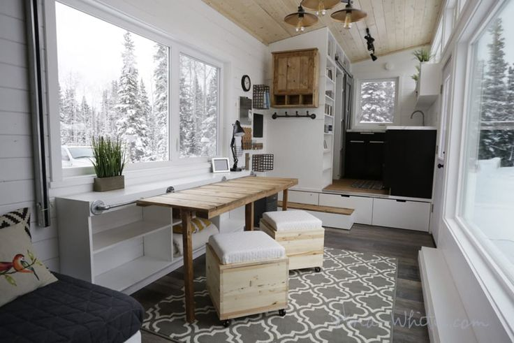 The Open Concept Rustic Modern Tiny House's storage unit, configured as one large desk