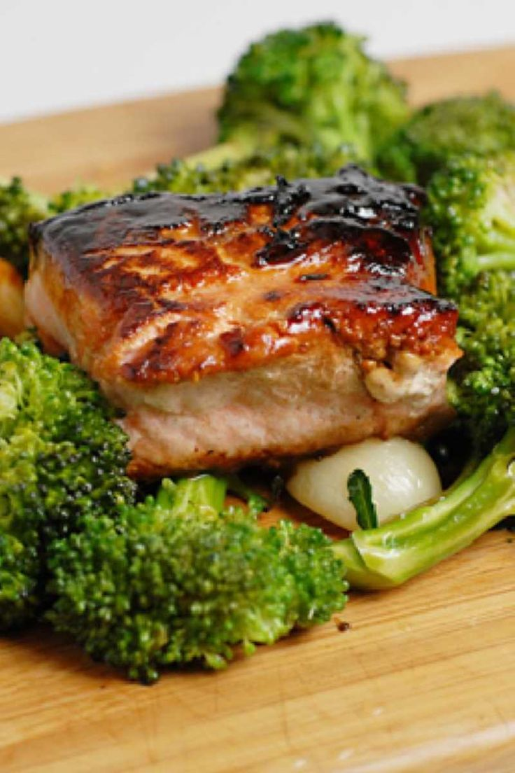 Blackened Salmon With Broccoli Rabe:6 oz skinless salmon fillet   2 tbsp cajun seasoning, or blackening spice mix   1 bunch broccoli rabe, (about 1 pound)   1 tbsp olive oil   2 shallot, sliced   1⁄4 tsp kosher salt   1⁄4 cup golden raisin   1 lemon, cut into wedges