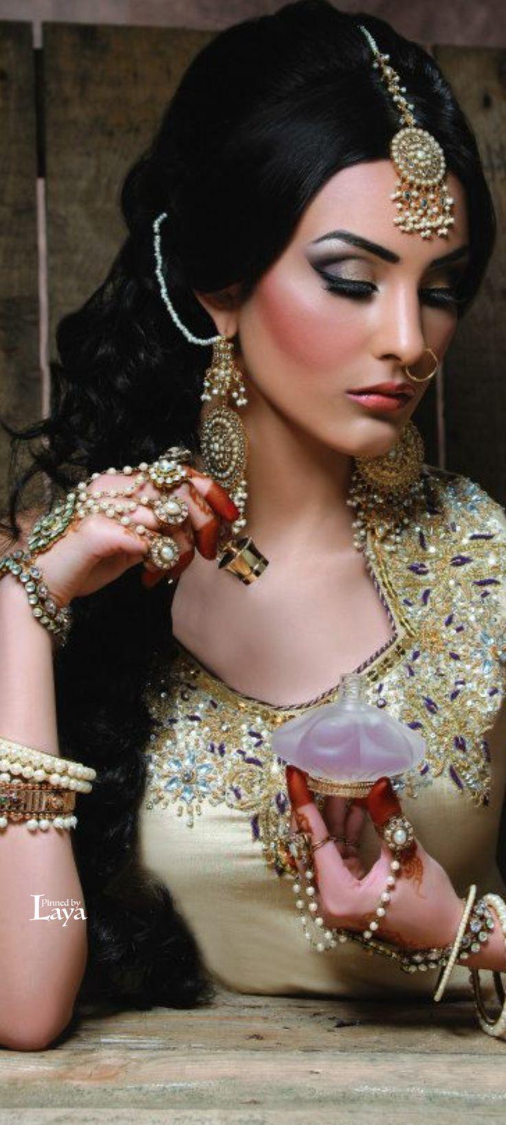 LAYA; regal gold South Asian bridal look. Her maang tikka and panja are so intricate and match her lehenga. #IndianWedding, #SouthAsianWedding, #ShaadiShop