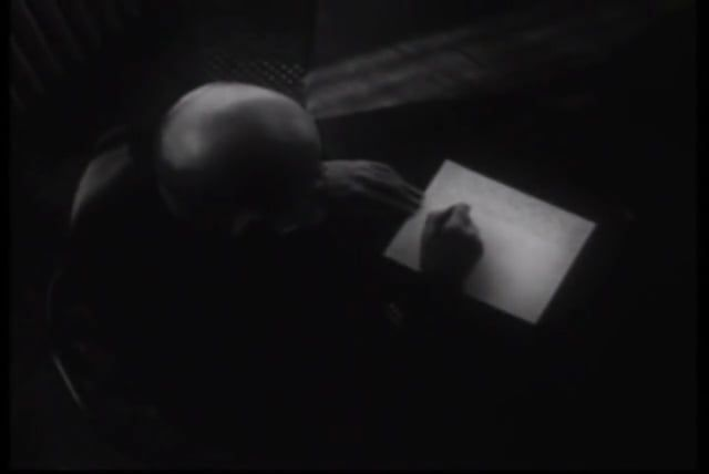 """A haunting and evocative film by the photographic master of mystic innuendo, Duane Michals.  This film is divided into sections, some of which reproduce in Michals' well-known photographic stories, sequential images that add up to form a narrative. """"The Bogeyman"""" is a child's nightmare in photo-animation. Did it happen, or not?  Then we get to a cryptic message from the artist, as though from beyond the grave (hence the title """"1939 - 1997""""). We watch over the artist's shoulder as he writ..."""