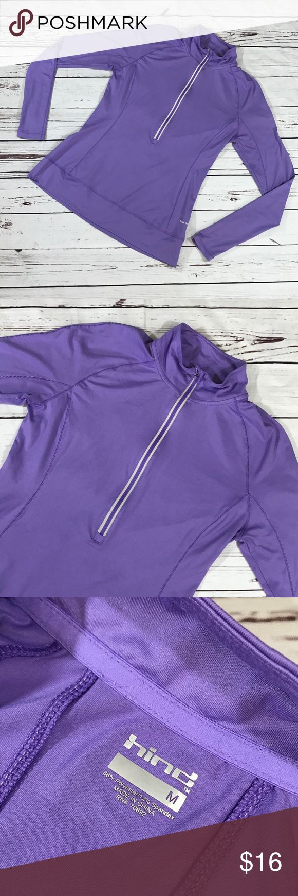 """Hind Half-Zip Long Sleeve Pullover Size M Hind long sleeve Purple half-zip pullover size M. Has a reflective zipper, thumbholes, form fitting. Perfect for running. Please feel free to ask questions. Fabric: 88% Polyester, 12% Spandex. Measurements approx: underarm to underarm 18"""", shoulder to hem 25"""". Hind Jackets & Coats"""