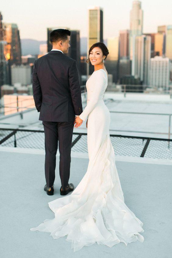 Stunning long sleeve dress with a textured chiffon train: http://www.stylemepretty.com/2016/02/17/modern-wedding-dresses/: