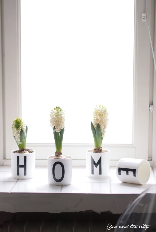 Flowers in Design Letters cups with typography by Arne Jacobsen. www.designletters.dk