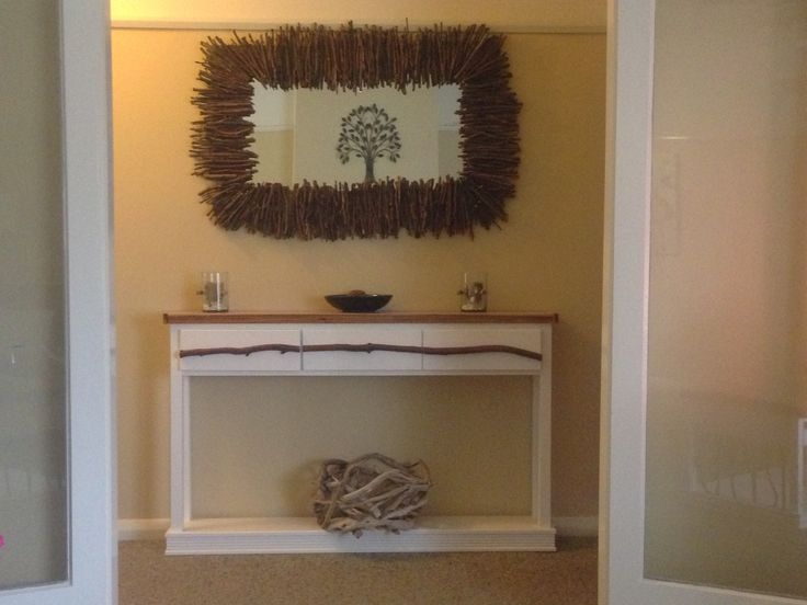 mirror my husband  and i made,hall way table and driftwood  basket my husband made