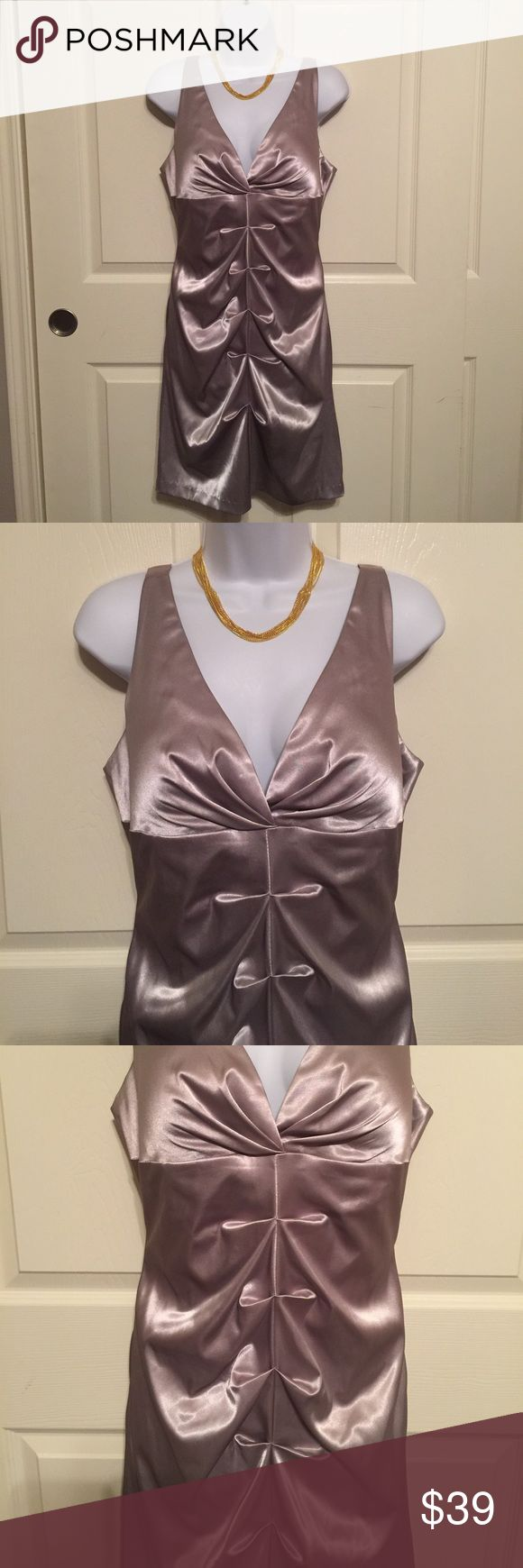 Onyx tan gray silver shinny night out dress 14P Onyx tan gray silver shiny soft body con night out dress. Size 14 petite. Made in the USA. Women's Ladies Fashion.  Pre-loved in excellent condition. Check out my closet, we have a variety of Victoria Secret, Bath and Body Works, handbags 👜 purse 👛 Aerosoles, shoes 👠fashion jewelry, women's clothing, Beauty products, home 🏡 decors & more...  Ships via USPS.  Always a FREE GIFT 🎁 with every purchase!!! Thank you. Onyx Dresses Mini