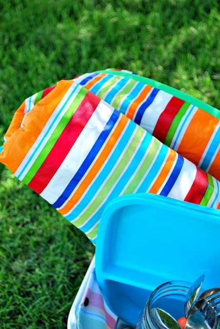 Just Another Day in Paradise: Vinyl Tablecloth Picnic Blanket Tutorial - I found vinyl tablecloths for under 2 dollars, bought a few for projects like this one!
