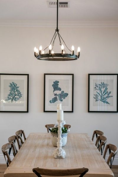 The dining room of our Hamptons Inspired home. Artwork by @Designer Boys Collections