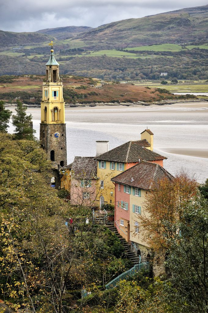 Portmeirion Bell Tower | Portmeirion is a popular tourist village in Gwynedd, North Wales. It was designed and built by Sir Clough Williams-Ellis between 1925 and 1975 in the style of an Italian village, and is now owned by a charitable trust. The village is located in the community of Penrhyndeudraeth, on the estuary of the River Dwyryd.