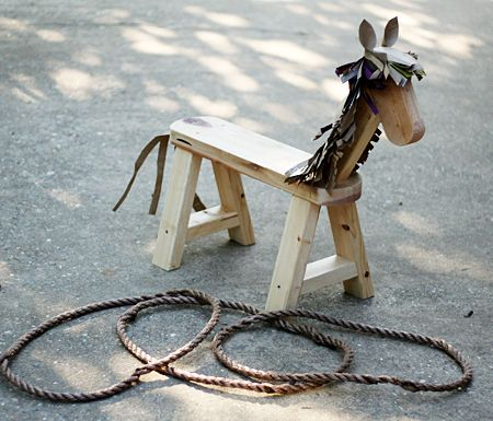 "Country western game idea - ""Dad made this cute wooden horse, and I added the paper bag mane and tail. We had three rope circle 'lassos' for the kids to throw. They loved this game!"""