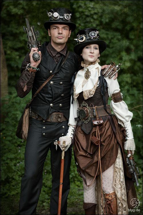 Armed Steampunk Couple - Steampunk Fashion Guide: Women and men's steampunk clothing inspiration, costume tutorials, guide to putting together an outfit, and calendar of upcoming Steampunk events. http://www.SteampunkFashionGuide.com