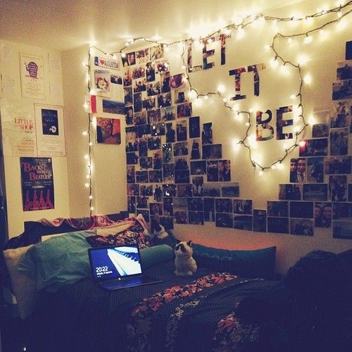 More pictures than I would like on my wall, but so cute! Is that a grumpy cat on the bed? lol