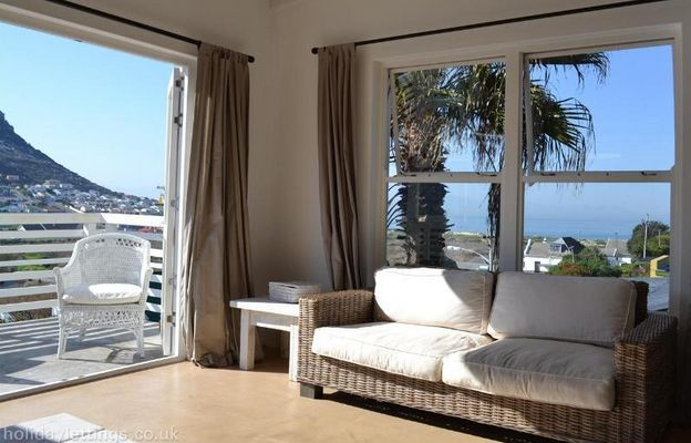 Self catering accommodation, Glencairn, Cape Town   Lounging area. Magnificent views.  http://www.capepointroute.co.za/moreinfoAccommodation.php?aID=391