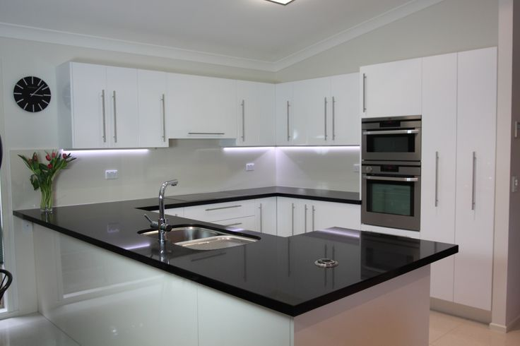Black benchtop, white cupboards. Classic style that never dates.