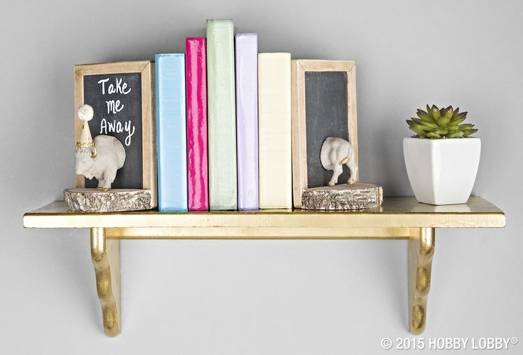 Want to earn a pile of extra quirk points? Saw an animal figurine in half, embellish each side as desired, and glue to a set of simple, homemade bookends (mini slate chalkboards glued to halves of a birch bark round).