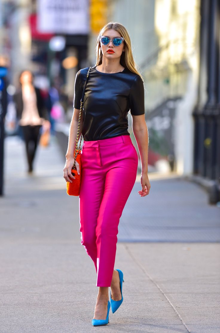 On the streets of SoHo for a shoot, Gigi stunned in hot-pink trousers and bright-blue pumps.