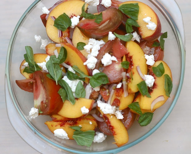 Enjoy this salad of heirloom tomatoes, peaches, basil, and red onion ...