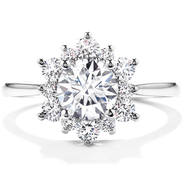 Hearts on Fire Delight Lady Di Diamond Engagement Ring: http://www.stylemepretty.com/2016/07/27/gold-rose-gold-platinum-engagement-ring-olympics/