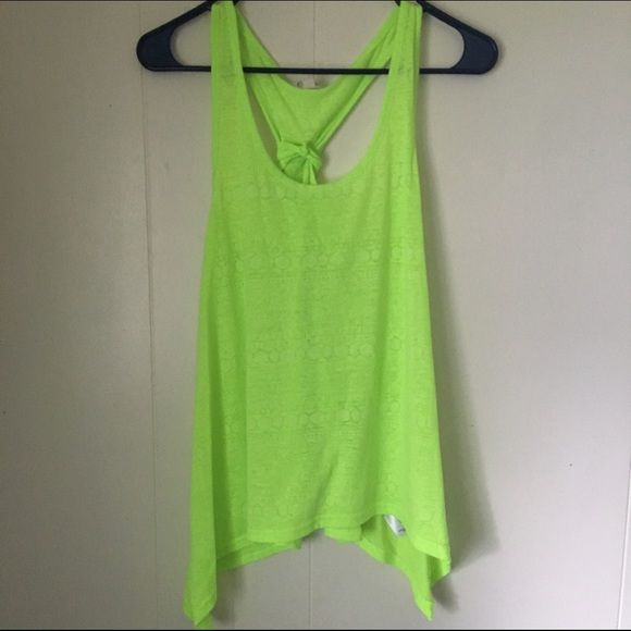 Neon Yellow/Green Tank Top Neon yellow/green color. Great condition! Worn twice. Has a cute Aztec pattern all over. Where the pattern is is semi sheer. Energie Tops Tank Tops