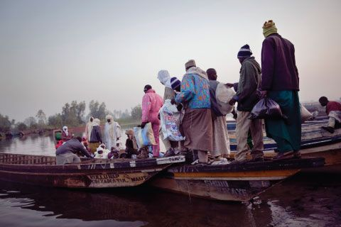 Passengers in Nigeria taking ferries to cross Lake Chad, whose shoreline is receding because the lake is drying up