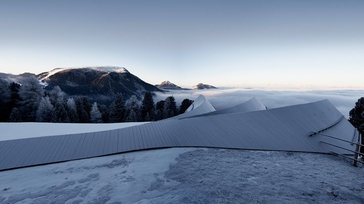 Three glass-fronted gables project from this mountain restaurant for skiers in the South Tyrolean Dolomites by Peter Pichler and Pavol Mikolajcak.
