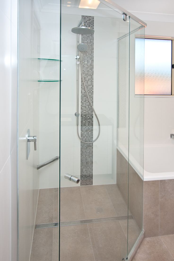 Add shelving and a footstep to your shower in the construction phase to save adding temporary solutions later. www.onecallkitchens.com.au