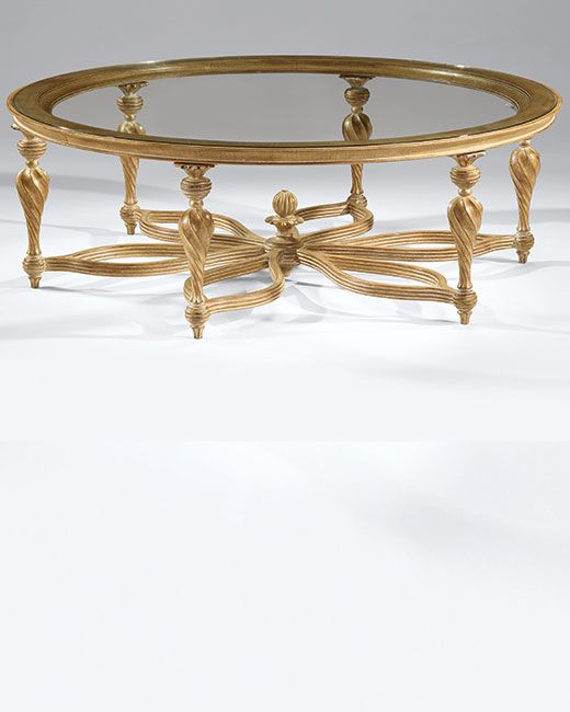 luxury coffee tables - 18th century French Neoclassic style round carved wood coffee table with rubbed light gold finish and clear glass top; made in Italy