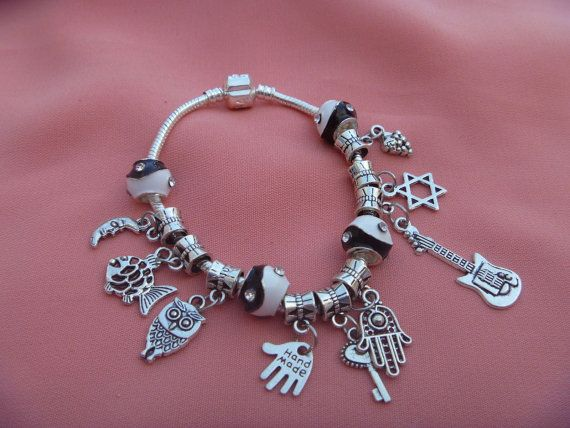 STERLING SILVER SNAKE charms  Bracelet 7 inches (17.78cm) with tibetan silver beads...